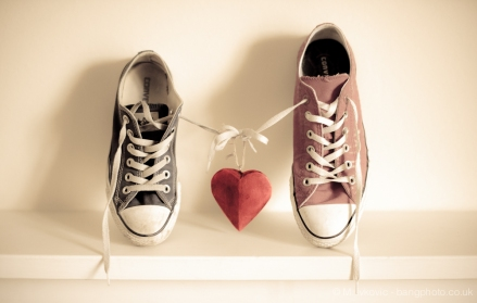 Converse trainers holding hands